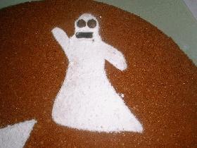 décorer les fantomes avec des pépites de chocolat