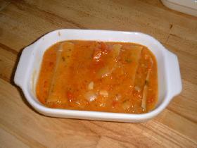 couvrir les cannelloni de cette sauce, saupoudrer de parmesan<br /> et enfourner pendant 30mn environ